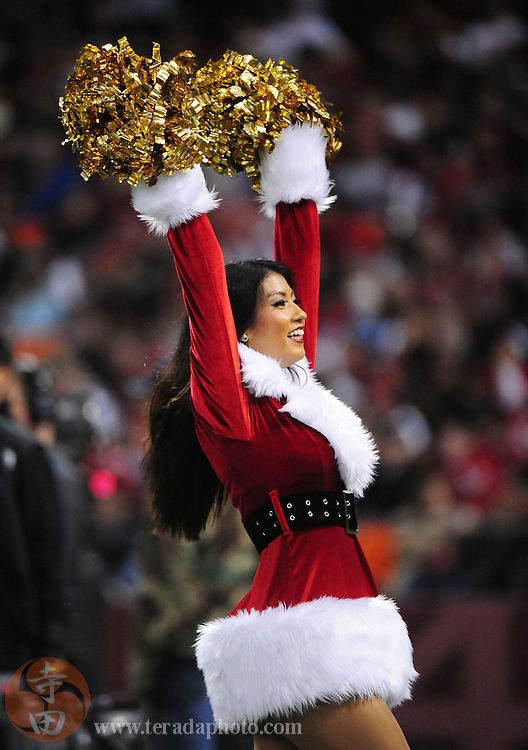 December 14, 2009; San Francisco, CA, USA; San Francisco 49ers Gold Rush cheerleader Tritia Ogata performs during the third quarter against the Arizona Cardinals at Candlestick Park. The 49ers defeated the Cardinals 24-9. Mandatory Credit: Kyle Terada-Terada Photo