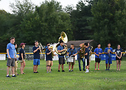Members of the AB junior high school band perform during halftime of a game between ABYB Bay State A Little League team and a visiting Chinese team from Beijing, the Powerbaseball Angels, at Veterans Field in Acton, Aug. 6, 2018. Acton won the game.   [Wicked Local Photo/James Jesson]
