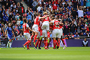 Arsenal players celebrate after the first goal in the stadium before the SSE Women's FA Cup Final match between Chelsea Ladies and Arsenal Ladies at Wembley Stadium, London, England on 14 May 2016. Photo by Nigel Cole