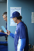LOS ANGELES, CA - AUGUST 22:  Manager Don Mattingly #8 of the Los Angeles Dodgers checks out the lineup before the game against the New York Mets at Dodger Stadium on Friday, August 22, 2014 in Los Angeles, California. The Dodgers won the game 6-2. (Photo by Paul Spinelli/MLB Photos via Getty Images) *** Local Caption *** Don Mattingly