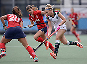 Surbiton's Hannah Martin runs past  SPV Complutense's Lucia Jimenez and Lola Riera Zuzarregui during their opening game of the EHCC 2017 at Den Bosch HC, The Netherlands, 2nd June 2017