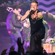 "WASHINGTON, DC - November 18, 2013 - Macklemore performs at the Verizon Center in Washington, D.C. The Heist, his 2012 album with producer Ryan Lewis, contained the #1 singles ""Thrift Shop"" and ""Can't Hold Us."" (Photo by Kyle Gustafson / For The Washington Post)"