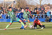 AFC Wimbledon forward Lyle Taylor (33)  fouls Curzon Ashton defender Jonathan Hunt (5)  during the The FA Cup match between Curzon Ashton and AFC Wimbledon at Tameside Stadium, Ashton Under Lyne, United Kingdom on 4 December 2016. Photo by Simon Davies.