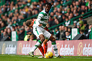 Celtic FC Defender Efe Ambrose and Dundee United Midfielder John Rankin ball for the ball during the Ladbrokes Scottish Premiership match between Celtic and Dundee United at Celtic Park, Glasgow, Scotland on 25 October 2015. Photo by Craig McAllister.