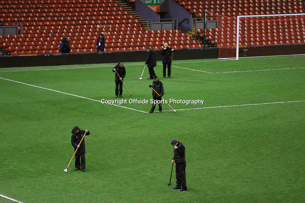 21 December 2014 - Barclays Premier League - Liverpool v Arsenal - Ground staff tend to the pitch which was described as 'awful' by Liverpool Manager, Brendan Rodgers after the game - Photo: Marc Atkins / Offside.