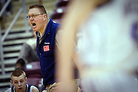 JEROME A. POLLOS/Press..Lake City High's coach Jim Winger yells for a foul call against Rocky Mountain High  Friday at the state 5A boys basketball tournament at Idaho Center in Nampa.