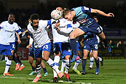 Wycombe Wanderers midfielder David Wheeler (7) heads the ball  at goal during the The FA Cup match between Wycombe Wanderers and Tranmere Rovers at Adams Park, High Wycombe, England on 20 November 2019.