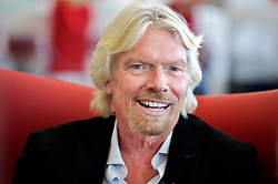 Virgin Group Founder Sir Richard Branson talks with reporters near the Virgin America gates in the new Terminal 2  at San Francisco International Airport.  The 640,000- square-foot Terminal is expected to be the first LEED Gold-certified terminal in the U.S.