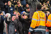 Millwall fans taunting the Charlton Athletic fans during the EFL Sky Bet Championship match between Millwall and Charlton Athletic at The Den, London, England on 9 November 2019.