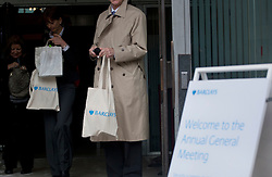 © licensed to London News Pictures. London, UK 27/04/2012. People leaving Barclays Annual General Meeting with Barclays bags at Royal Festival Hall in London, today (27/04/12). Photo credit: Tolga Akmen/LNP