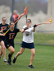 Virginia Cavaliers A Megan Havrilla (15) passes the ball around Princeton Tigers A Ashley Amo (11).  The Virginia Cavaliers women's lacrosse team defeated the Princeton Tigers 9-7 at Klockner Stadium in Charlottesville, VA on March 24, 2007.