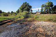 Church near pumpjacks in an oil field in Hosston, Louisiana, part of the Haynsville Shale region.