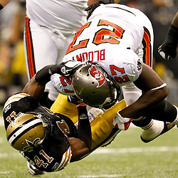November 5, 2011; New Orleans, LA, USA; New Orleans Saints safety Roman Harper (41) tackles Tampa Bay Buccaneers running back LeGarrette Blount (27) during the first quarter of a game at the Mercedes-Benz Superdome. Mandatory Credit: Derick E. Hingle-US PRESSWIRE