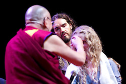 © Licensed to London News Pictures. 16/06/2012. Manchester , UK . The Dalai Lama talks to Kila Curran Coleman, 13 , from County Limerick in the Republic of Ireland as Russell Brand looks on . Kila won an award for forgiveness. Her father  , Pat Coleman , was murdered in Limerick six years ago in an unprovoked attack and she wrote a letter of forgiveness to her father's killer . Russell Brand and The Dalai Lama at the Manchester Arena , Greater Manchester , at the Stand Up and Be the Change youth event . The Dalai Lama is on a 10 day tour of the UK . Photo credit : Joel Goodman/LNP