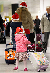 A family  at London Gatwick airport as the Christmas getaway starts Friday, 20th December 2013. Picture by Stephen Lock / i-Images