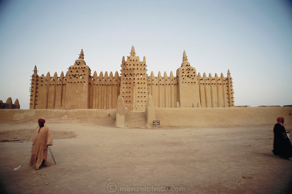 The mud-walled Great Mosque in the African city of Djenne, in Mali was built decades ago on the ruins of a 13th-century mosque. Architecture. Published in Material World, page 20-21.