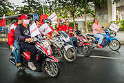 "10 DECEMBER 2012 - BANGKOK, THAILAND:   Red Shirt motorcyclists go to Pheu Thai offices on Petchaburi Road in Bangkok Monday. The Thai government announced on Monday, which is Constitution Day in Thailand, that will speed up its campaign to write a new charter. December 10 marks passage of the first permanent constitution in 1932 and Thailand's transition from an absolute monarchy to a constitutional monarchy. Several thousand ""Red Shirts,"" supporters of ousted and exiled Prime Minister Thaksin Shinawatra, motorcaded through the city, stopping at government offices and the offices of the Pheu Thai ruling party to present demands for a new charter.       PHOTO BY JACK KURTZ"