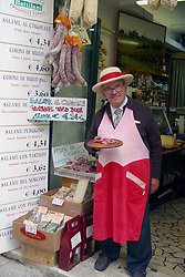 Tuscany, Italy:  Il Cinghiale, or wild boar, makes a tasty sausage. Free samples of this Tuscan specialty often are available from the various delis that line the streets of Castiglione del Lago.