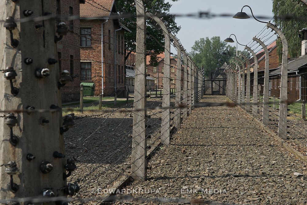 Auschwitz; Nazi concentration camp; electric fence separating guards and inmates.