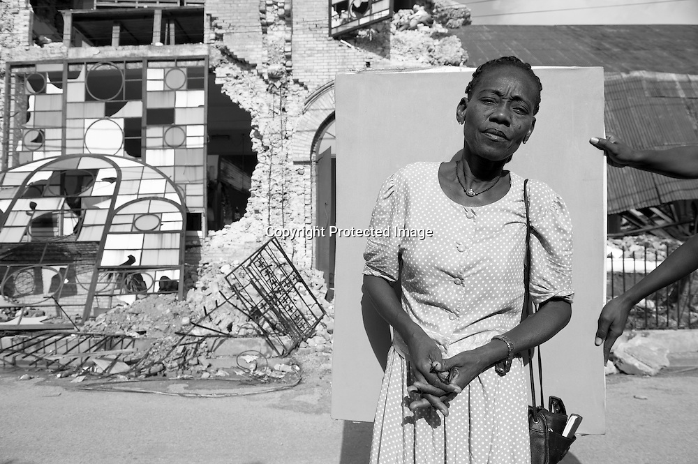 Carole Charles, 52, outside of Sunday mass at Sacred Heart in Port-au-Prince. When the quake hit, she was visiting a flower shop and she sensed a voice telling her to move quickly. She grabbed two family members, including a 4-year old child, and ran outside. As she knelt in the street, praying, she says it was as though the wind demolished houses all around her.