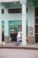 Man smokes a cigar in Santa Clara Cuba.