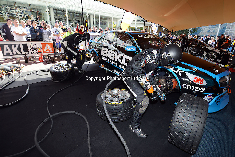 Will Davison's pit crew at work, V8 Supercar drivers participate in a pit stop competition and fan signing session in Aotea Square, Queen St, Auckland ahead of this weekends ITM 500. 23 April 2014. Photo: Andrew Cornaga/www.photosport.co.nz