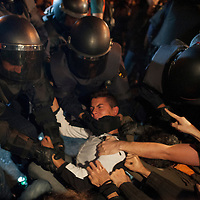 26/09/2012. Police clash with protestors during the demonstration at the parliament against austerity measures announced by the Spanish government in Madrid, Spain, Wednesday, Sept. 26, 2012. Spain's Parliament has taken on the appearance of a heavily guarded fortress with dozens of police blocking access from every possible angle, hours ahead of a protest against the conservative government's handling of the economic crisis. ©Sylvain Cherkaoui