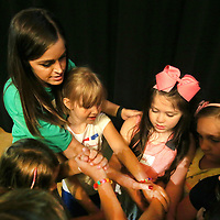 Danielle Frerer, helps her campers at the TCT Camp, work through the Knot Game as they have activity time on the stage before practicing their lines.