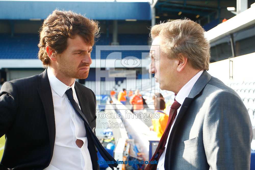 Picture by Andrew Tobin/Focus Images Ltd. 07710 761829. 23/10/11. Andre Villas Boas, manager of Chelsea (L) and Neil Warnock, manager of QPR (R) discuss other Premier League teams before the Barclays Premier League match between QPR and Chelsea at Loftus Road, London.
