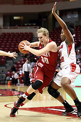 30 January 2015:  Whitney Tinjum tries to force herself into the paint against Zenobia Bess during an NCAA women's basketball game between the Bradley Braves and the Illinois Sate Redbirds at Redbird Arena in Normal IL