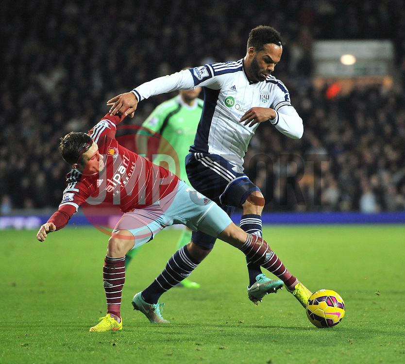 West Bromwich Albion's Joleon Lescott is challenged by West Ham's Aaron Cresswell - Photo mandatory by-line: Dougie Allward/JMP - Mobile: 07966 386802 - 02/12/2014 - SPORT - Football - West Bromwich - The Hawthorns - West Bromwich Albion v West Ham United - Barclays Premier League