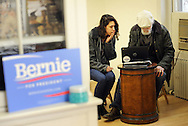 Bucks County Campaign manager Lena Glickman (left) of Philadelphia, Pennsylvania and Val Sigstedt of Point Pleasant, Pennsylvania converse in the new Bernie Sanders democratic campaign headquarters Saturday April 2, 2016 in Doylestown, Pennsylvania.  (Photo by William Thomas Cain)
