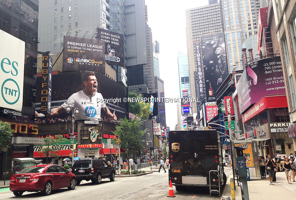 GARETH BALE<br /> towers over Times Square in New York City in advertisement for NBC Sports to publicise the new Premier League season.<br /> The ad raise doubts about Bale's likely move from Tottenham Hotspurs to Real Madrid.<br /> Mandatory Credit Photo: &copy;Andy Dias/NEWSPIX INTERNATIONAL<br /> <br /> **ALL FEES PAYABLE TO: &quot;NEWSPIX INTERNATIONAL&quot;**<br /> <br /> IMMEDIATE CONFIRMATION OF USAGE REQUIRED:<br /> Newspix International, 31 Chinnery Hill, Bishop's Stortford, ENGLAND CM23 3PS<br /> Tel:+441279 324672  ; Fax: +441279656877<br /> Mobile:  07775681153<br /> e-mail: info@newspixinternational.co.uk
