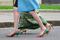 © Licensed to London News Pictures. 13/09/2016. London, UK. Detail showing the shoes worn as British prime minister THERESA MAY (front) greets Myanmarese politician AANG SAN SUU KYI (rear) on the steps of 10 Downing Street ahead of a meeting between the two leaders.  Photo credit: Ben Cawthra/LNP