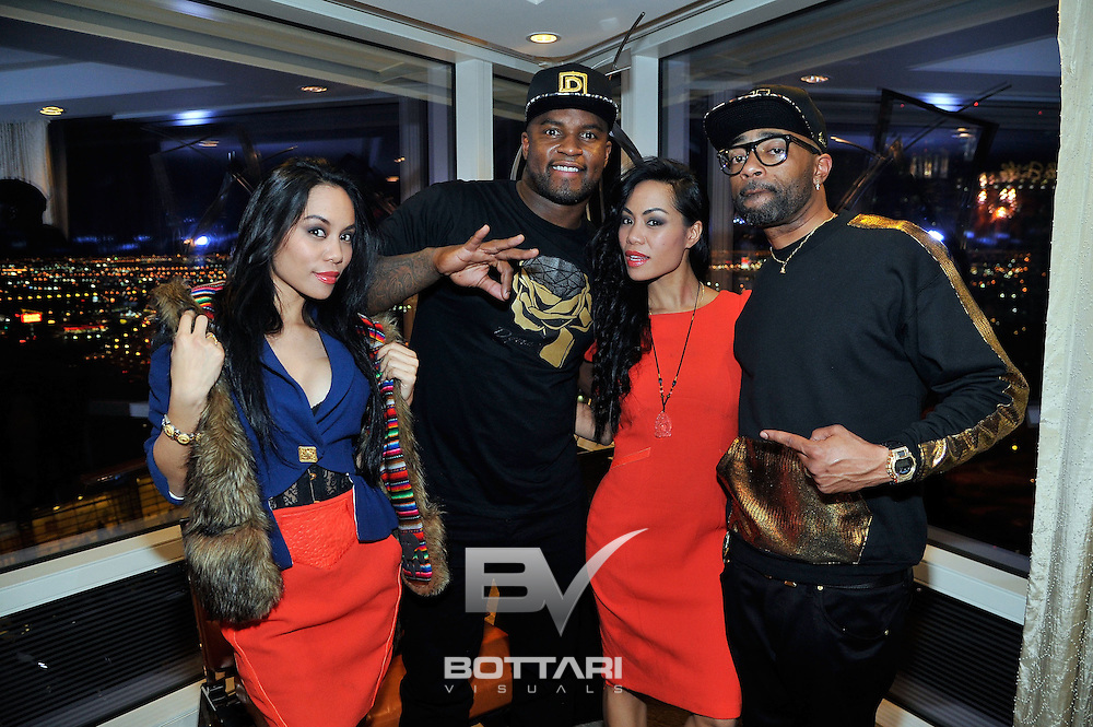LAS VEGAS, NV - FEBRUARY 19:  (L-R) Designer To-Tam Sachika, DYME LYFE CEO and owner DJ Williams, designer To-Nya Sachika and CEO of Flaucy Nate Willis attend the FlauSachika Groups exclusive magic suite party at Aria Resort & Casino at CityCenter on February 19, 2013 in Las Vegas, Nevada.  (Photo by Jeff Bottari/WireImage)