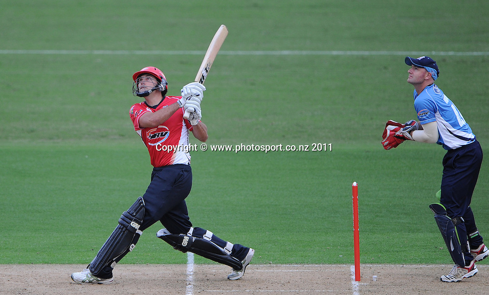 Dean Brownlee hits a 6 during the HRV Twenty20 Cricket match between the Auckland Aces and Canterbury Wizards at Colin Maiden Oval in Auckland, New Zealand on Tuesday 17 January 2012. Photo: Andrew Cornaga/Photosport.co.nz