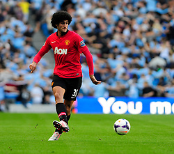 Manchester United's Marouane Fellaini - Photo mandatory by-line: Dougie Allward/JMP - Tel: Mobile: 07966 386802 22/09/2013 - SPORT - FOOTBALL - City of Manchester Stadium - Manchester - Manchester City V Manchester United - Barclays Premier League