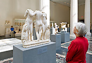 People viewing sculpture in the Greek and Roman Galleries at The Metropolitan Museum of Art, the Met, New York City.