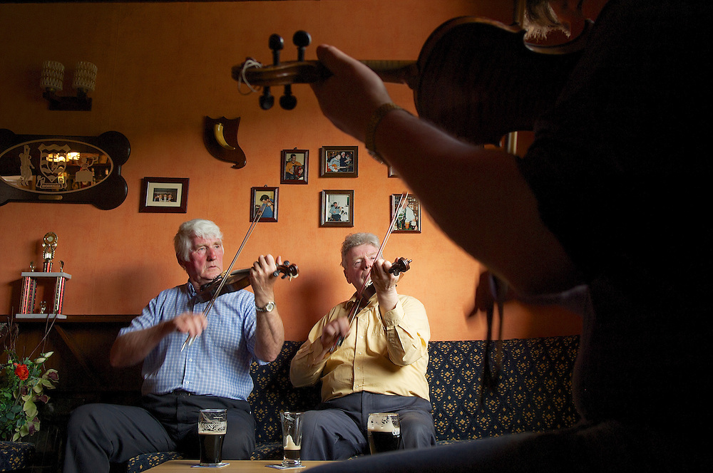 Jimmy (left) and Vincent (right) Campbell play in The Glen Tavern in Glenties, County Donegal, Ireland.  The brothers are legends in Irish traditional fiddling.