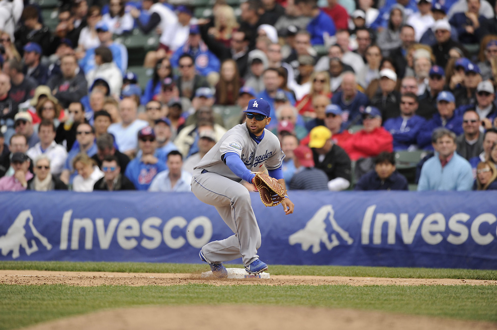 CHICAGO - MAY  04:  James Loney #7 of the Los Angeles Dodgers fields against the Chicago Cubs on May 4, 2012 at Wrigley Field in Chicago, Illinois.  The Cubs defeated the Dodgers 5-4.  (Photo by Ron Vesely)   Subject:  James Loney