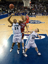 Old Dominion forward Jessica Canady (24) beats Liberty guard/forward Megan Frazee (40) to a rebound.  The #5 seed Old Dominion Lady Monarchs defeated the #12 seed Liberty Flames 82-62 in the first round of the 2008 NCAA Division 1 Women's Basketball Championship in Norfolk, VA on March 23, 2008
