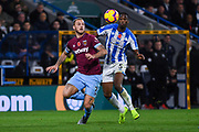 Marko Arnautovic of West Ham United (7) and Terence Kongolo of Huddersfield Town (5) come together to try win the bouncing ball during the Premier League match between Huddersfield Town and West Ham United at the John Smiths Stadium, Huddersfield, England on 10 November 2018.
