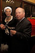 Julian Fellowes and Lady Emma Kitchener-Fellowes. Reception to support the Hyde Park Appeal for Liberty Drives ( a charity which enables people to travel around Hyde Park in electric buggies) in the presence of Prince Michael of Kent. Officers Mess. Household Cavalry Mounted Regiment. Hyde Park Barracks. 30 November 2004. ONE TIME USE ONLY - DO NOT ARCHIVE  © Copyright Photograph by Dafydd Jones 66 Stockwell Park Rd. London SW9 0DA Tel 020 7733 0108 www.dafjones.com
