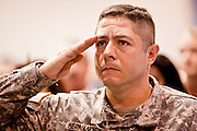 "July 2 - PHOENIX, AZ: US Army PFC JORGE HERNANDEZ, originally from Mexico, salutes while he is sworn in as a US citizen Friday. Nearly 200 people were sworn in as US citizens during the ""Fiesta of Independence"" at South Mountain Community College in Phoenix, AZ, Friday. The ceremony is an annual event on th 4th of July weekend and usually the largest naturalization ceremony of the year in the Phoenix area.  Photo by Jack Kurtz"
