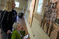 Janet Smith visits the Human Rights Education Institute's art display with her Hospice of North Idaho volunteer Wednesday, June 8, 2011 in Coeur d'Alene, Idaho.