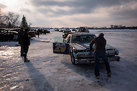 Racers take to the ice to race their cars on the frozen Lake Sinissippi Sunday, Feb. 28, 2015, in Hustisford Wi. (AP Photo/Darren Hauck)