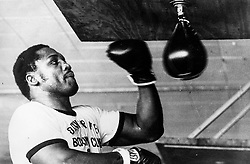 'Smokin' Joe' Frazier (born January 12, 1944 in Beaufort, South Carolina) 1968 world heavyweight boxing champion, was the first American boxer to win both the Olympic gold medal and the professional world title in the heavyweight division. Frazier is considered one of the greatest heavyweights of all time, but he is perhaps most famous for his trilogy of fights Ali, the first of which, won by Frazier in a unanimous decision, has often been called one of boxing's greatest bouts. Frazier was known for a relentless pursuit of opponents, quickly cutting off angles of escape using a chugging locomotion reminiscent of a train's advance up a hill. The contrast with Ali's dancing, non-linear style could not have been greater. Winner of Olympic 1964 Tokyo Gold medal for Boxing - Heavyweight. He had a band called 'Joe Frazier & the Knockouts' that released songs in the 'soul' genre. In the 1990s, he trained award winning artist Richard T. Slone to box. Operated a boxing gym in North Philadelphia since the late 1960s, used by fighters such as Michael Spinks, Meldrick Taylor, his son Marvis Frazier, and Bernard Hopkins. Father of 11 children..PICTURED: Working out.