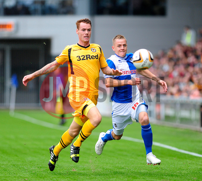 Bristol Rovers' Eliot Richards and Newport County's Tom Naylor give chase to loose ball  - Photo mandatory by-line: Dougie Allward/JMP - Tel: Mobile: 07966 386802 17/08/2013 - SPORT - FOOTBALL - Rodney Parade - London - Newport County V Bristol Rovers - Sky Bet league two
