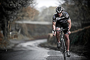 9-12-2012 Cheshire UK. Cyclist on Cheshire lanes