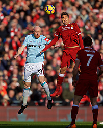 LIVERPOOL, ENGLAND - Saturday, February 24, 2018: Liverpool's Roberto Firmino and West Ham United's James Collins during the FA Premier League match between Liverpool FC and West Ham United FC at Anfield. (Pic by David Rawcliffe/Propaganda)